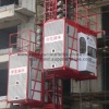 worker and material load construction elevator
