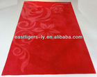 red and white design tufted rugs