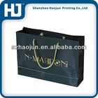 Specialty paper packaging bag with golden nylon rope
