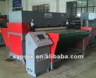 Conveyor feeding hydraulic plastic bag making machine