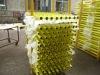 Yellow powder coated scaffolding standard