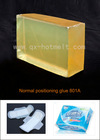 Positioning adhesive for sanitary napkins