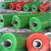Durable conveyor roller for handling material