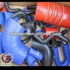 Cold side hoses with polyester fabric reinforcement