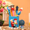 Polymer clay pen and pencil holder with Santa Claus