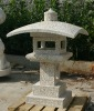 carved stone garden lamp holder