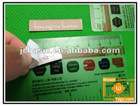 Adhesive woven clothing labels