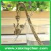 Embossed metal bookmark clip