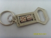dog tag,badge,bottle opener,belt buckle,key chain