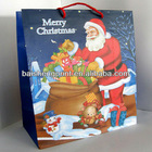 lovely cartoon Santa Claus and paper lady hand bag