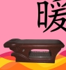 Massage bed with electrically heated