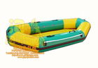 single green inflatable boat